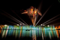 Firework displays and fireworks. Fireworks Celebration Event.Shiny surface reflects light. Nong Prajak park Udon Thani, Thailand Royalty Free Stock Image