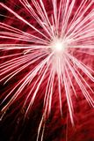 Firework explosion. Bright firework on red exploding in celebration Stock Photography