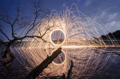 Firework and fire swing on dead tree fourground. Firework and fire swing for party on dead tree fourground entertain peaple stock photography