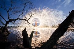 Firework and fire swing on dead tree fourground. Firework and fire swing for party on dead tree fourground entertain peaple royalty free stock photos
