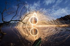 Firework and fire swing on dead tree fourground. Firework and fire swing for party on dead tree fourground entertain peaple stock images