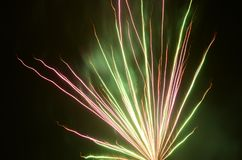 Firework flower structure with red and green colors royalty free stock photography