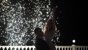 Firework fountains at the end of the wedding. People have fun, dance and hugging together. Aerial drone shot stock video