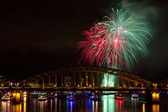 Firework in green and red colors Stock Images