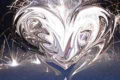 Firework heart. Watery looking heart shape in the center of firework explosion Stock Photography