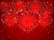 Firework with hearts on red background Stock Images