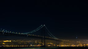 Firework near the 25 de Abril Bridge in Lisbon Portugal stock video