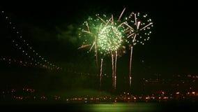Firework at Night near Illuminated Bridge stock video