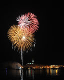 Firework over city Rovinj. Orange red firework over city Rovinj on the sea Royalty Free Stock Photography