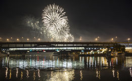 Firework over Moscow -- Moskva River, Luzhnetskaya Bridge Metro Bridge in the light of night colored lights. Moscow, Russia Stock Photography