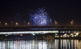 Firework over Moscow -- Moskva River, Luzhnetskaya Bridge Metro Bridge in the light of night colored lights. Moscow, Russia Stock Images