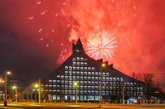 Firework over National Library of Riga. Red firework over National Library of Riga at night. Celebrating independence day Royalty Free Stock Image