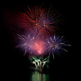 Firework over the water in the night sky Royalty Free Stock Photos
