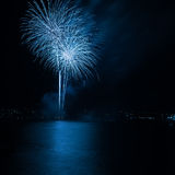 Firework. Over the water in the night sky Stock Photos