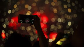 Firework, public, smartphones. Holiday backgrounds. stock footage