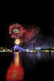 Firework at Putrajaya. Fireworks are widely used to produce the four primary effects: noise, heat / light colored, smoke, and floating materials (like confetti) royalty free stock photos