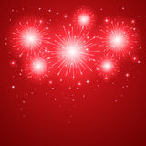 Firework on red background Stock Images