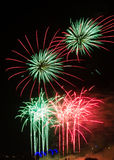 Firework in red and green Royalty Free Stock Image