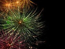 Firework reflection. Abstract of fireworks reflected in shiny cobbled pavement with copyspace Royalty Free Stock Photos