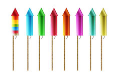 Firework rockets. Eight firework rockets with different colors, isolated Stock Photos