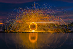 Firework showers of hot glowing sparks from spinning steel wool stock photo