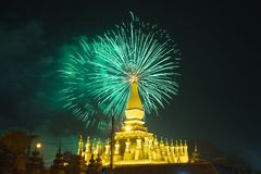 firework shown behide Buddhist Temple in Vientiane, Lao PDR. royalty free stock photography