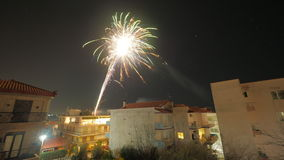Firework in small town at night Royalty Free Stock Images