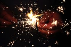Firework Sparklers in Hand Royalty Free Stock Images