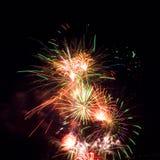 Firework streaks in night sky, celebration Stock Photo
