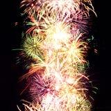 Firework streaks in night sky, celebration Royalty Free Stock Images