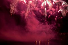 Firework on a swiss lake. Next to Bern. Celebration of the summer stock photos