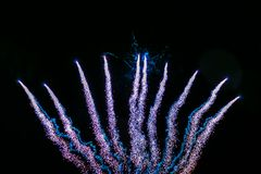 Firework volley in the night sky royalty free stock photography