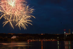 Firework on the water in the night city. Reflections in the river Stock Images
