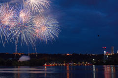 Firework on the water in the night city. Reflections in the river Stock Photo