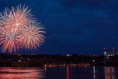 Firework on the water in the night city Royalty Free Stock Photography