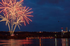 Firework on the water in the night city Stock Images