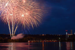 Firework on the water in the night city Royalty Free Stock Photo