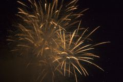 Fireworks_1. Golden colored fireworks in dark night time sky royalty free stock photos