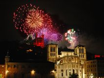 Fireworks. Colorful fireworks sparkle over the basilica (Fourviere) and the cathedral (St Jean) in the city of Lyon (France) 14 july is the French national Day Royalty Free Stock Photo