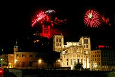Fireworks. Colorful fireworks sparkle over the basilica (Fourviere) and the cathedral (St Jean) in the city of Lyon (France) 14 july is the French national Day Royalty Free Stock Photos
