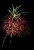 Beautiful fireworks display lights up the nighttime sky Royalty Free Stock Photo