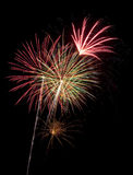 Beautiful fireworks display lights up the nighttime sky Royalty Free Stock Photography