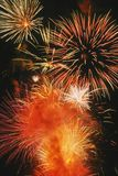 Beautiful fireworks display lights up the nighttime sky Royalty Free Stock Images