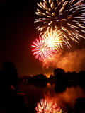 Fireworks. And reflection on water Royalty Free Stock Photography