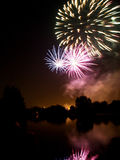 Fireworks. And reflection on water Stock Photography