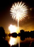 Fireworks. And reflection on water Stock Images