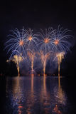 Fireworks. Beautiful fireworks above the water royalty free stock images