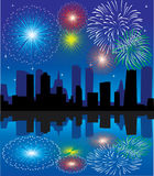 Fireworks. Over city with reflection Royalty Free Stock Photo