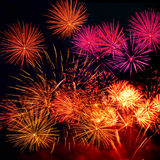 Fireworks. Holiday salute in the night sky royalty free stock image
