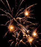 Fireworks. Brightly coloured fireworks against a black night sky stock photography